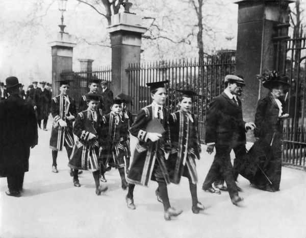 Seven Chapel royal boy choristers make their way along the street towards Buckingham Palace for an 11 o'clock service, on the occasion of the King's return to London