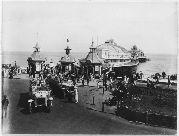 Charabancs drop their passengers at the entrance to the pier in Eastbourne, East Sussex