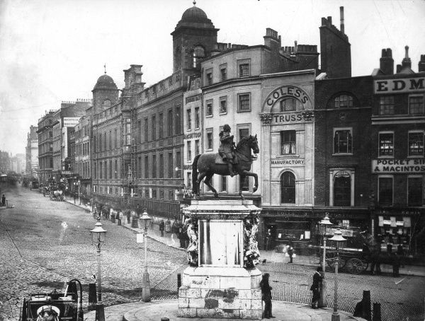 Photograph showing Charing Cross, London, c.1880. The photographer used an exposure of sufficient length to blur some of the moving vehicles and pedestrians, but retain the stationary ones perfectly