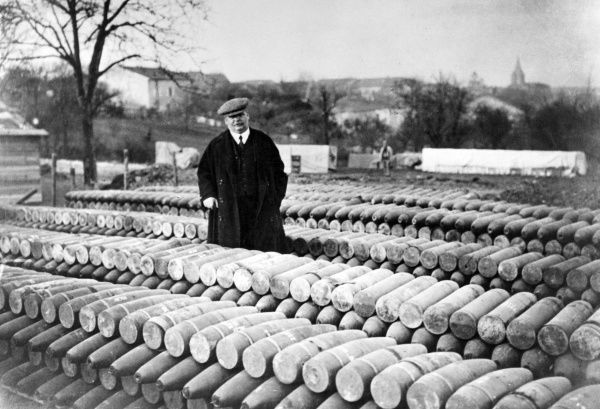 Charles Humbert (1866-1927), French army captain, tax collector, senator and newspaper proprietor. Seen here with piles of munitions destined for Verdun, France, during the First World War. Date: circa 1916