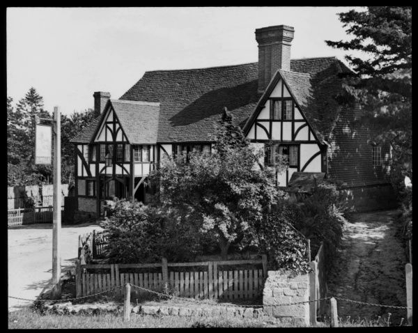 A Charles Wells Public House, in an unidentified location. This brewery company, based in Bedfordshire, is still in existence today, with over 200 pubs to its name
