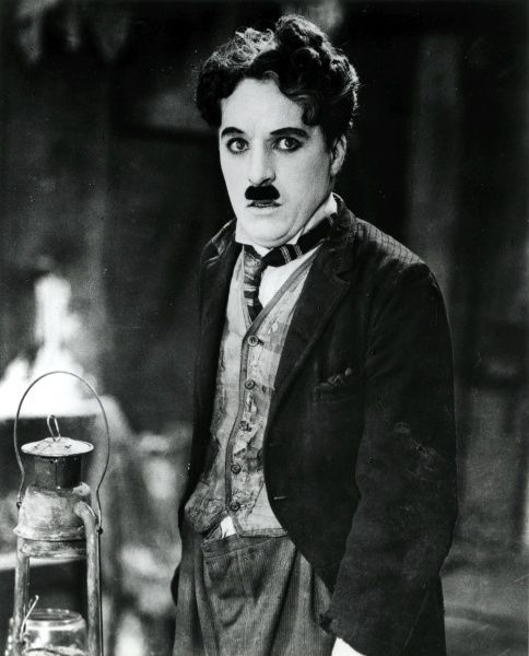 Film actor and director Charlie Chaplin (1889-1977), film star and director, seen here in his 'little tramp' costume, probably in a still from his 1925 film, The Gold Rush