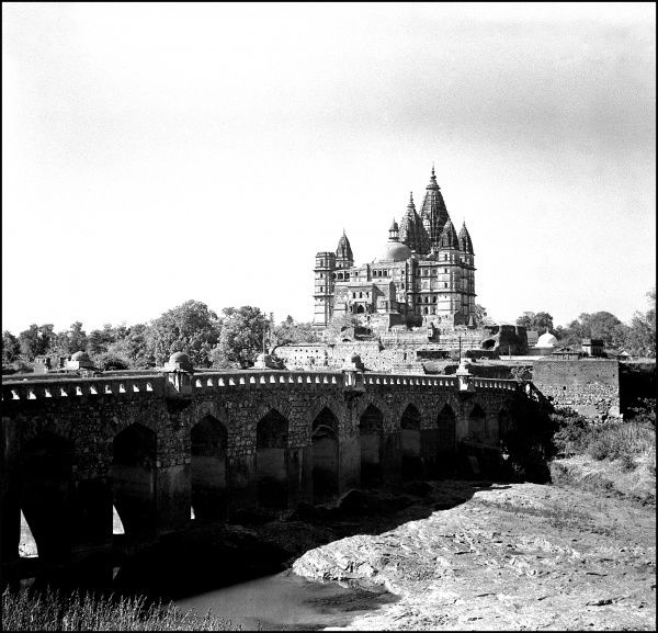The bridge leading toward the imposing outline of the Chaturbhuj Temple, Orchha, Madhya Pradesh Province, India. Photograph by Ralph Ponsonby Watts