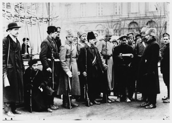 Members of the Red Guard check people's identification papers in the streets of Petrograd : revolutions come and go, but bureaucracy is for ever
