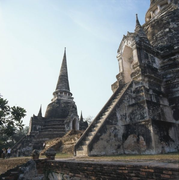 View of two of the three bell-shaped Chedis (royal tombs) of the Wat Phra Si Sanphet temple (constructed between 1492 and 1532) at Ayutthaya, Thailand