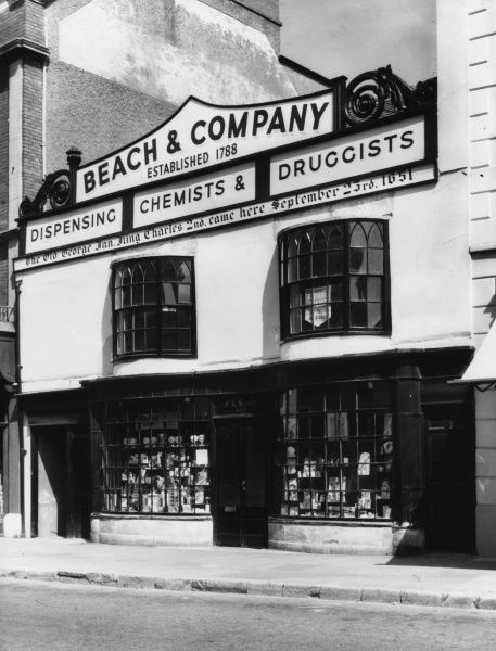'Beach and Company' dispensing chemists and druggists, established 1788, in Bridport, Dorset, England. Formerly the the 'Old George Inn' where Charles II stayed in 1651