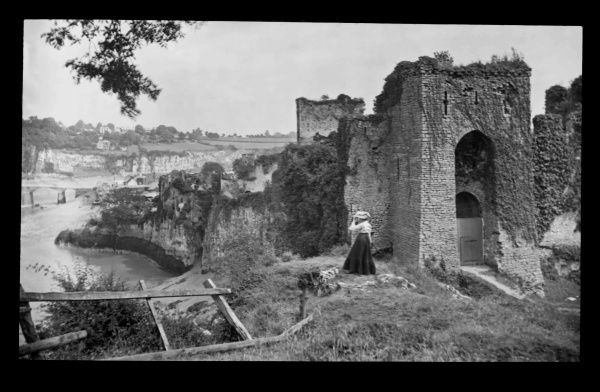 Edwardian woman at Chepstow Castle, overlooking the River Wye at Gwent (formerly Monmouthshire), Wales. Building began in the 11th century, making this the oldest surviving stone fortification in Britain