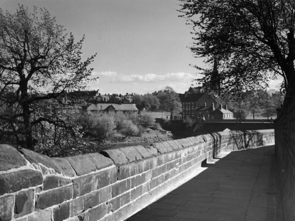 A view from the city walls at Chester, Cheshire, England, looking towards Handbridge, a suburb of this historic city. Date: 1960s