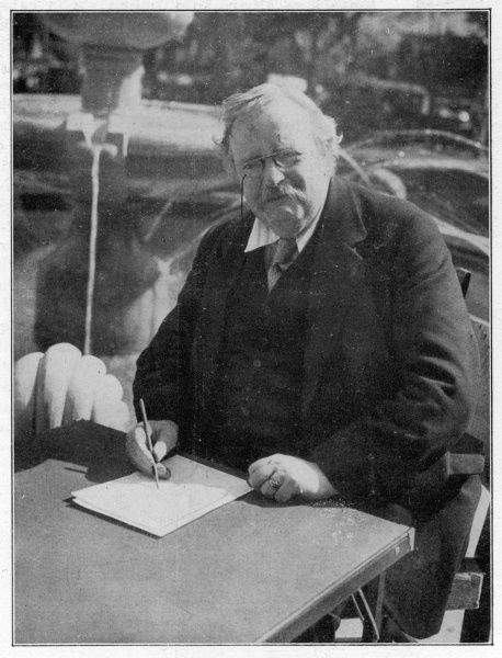 GILBERT KEITH CHESTERTON Writer, caught by the photographer in the act of writing something, showing clearly the way he holds his pencil