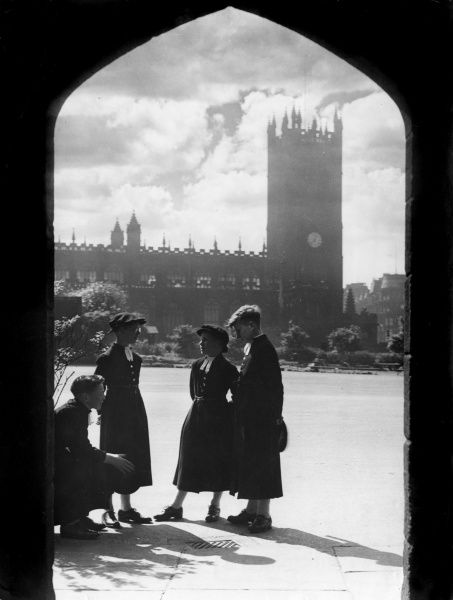 Boys of this school in Lancashire wearing traditional Tudor costume, the Cathedral in the background. Many Manchester Cathedral choir- boys are from this school. Date: 1930s