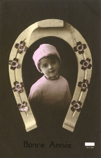 Girl with a horseshoe to wish a 'Good Year' - a few months later World War One began... Date: 1914