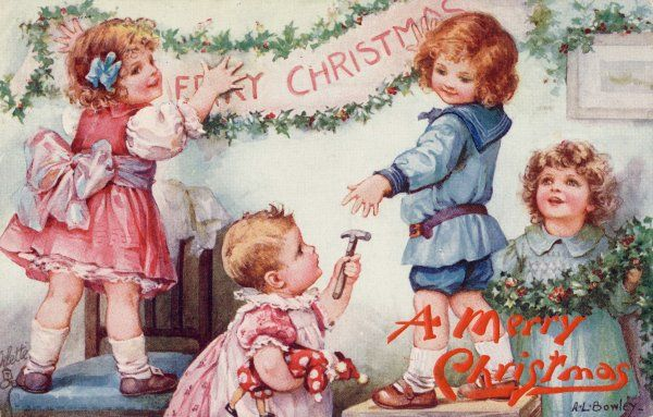 'Pass me the hammer, please !' Four small children hang up a Christmas banner