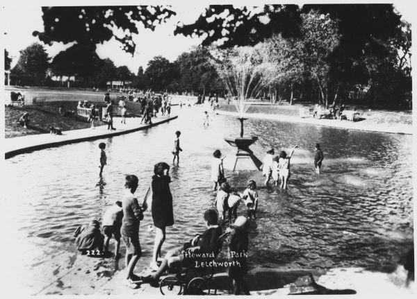 Children play and paddle happily in the pool at Howard Park in Letchworth