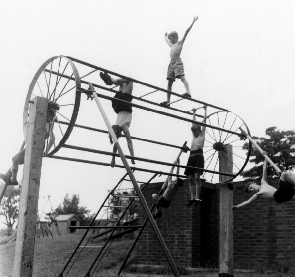 Children on a climbing frame in a playground at Bramfield Primary School, Suffolk. Date: July 1957