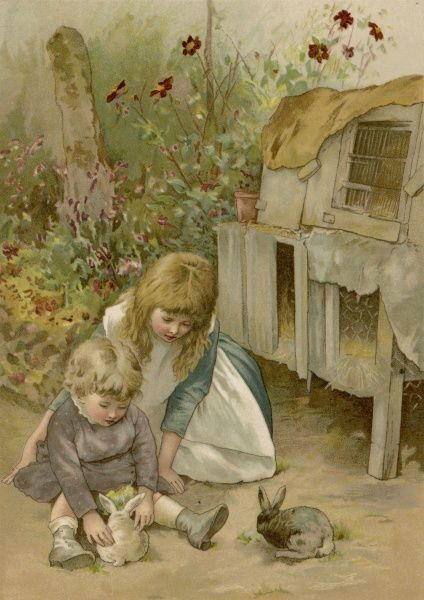 Two children with their pet rabbits