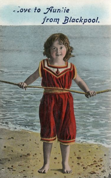 A little girl in a red one- piece swimming costume on the beach sends 'Love to Auntie from Blackpool'. Date: circa 1910