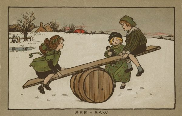See-Saw. Children playing happily on a see-saw in a winter landscape