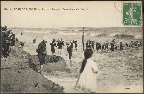 French children using 'la corde' - a safety rope which, so long as they hold on to it, will prevent them being swept out to sea and drowned