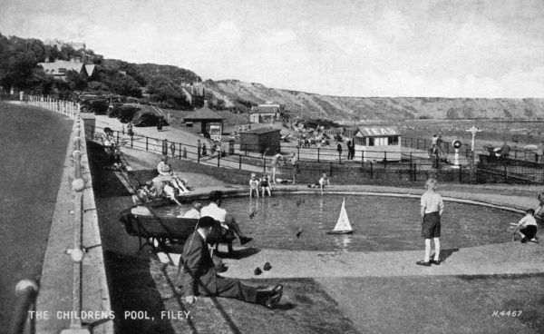 View of the children's boating pool at Filey, North Yorkshire. Date: 1940s