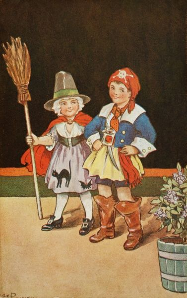 Two children dressed up for a fancy dress party. A little girl has a rather nice witch outfit with a dress appliqued with black cats and a broom, while a little boy has come as a swashbuckling pirate