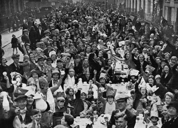 One of the many tea-parties held in the streets of London for poor children, in celebration of the Silver Jubilee of King George V
