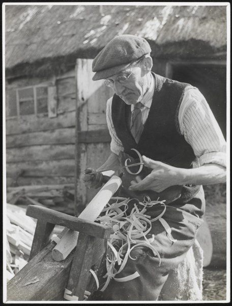 A Chiltern woodworker shaves a piece of wood, probably a chair or table leg