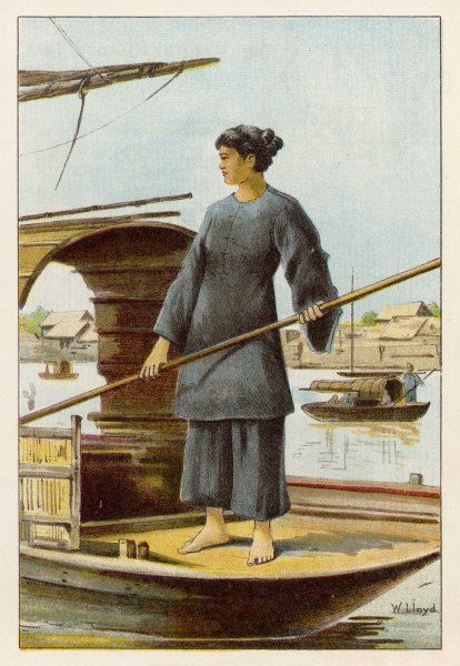 A barefoot Chinese woman guides her sampan on the river at Canton, using a pole