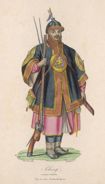 A Chinese soldier from Peking in fine multi-coloured ceremonial military costume