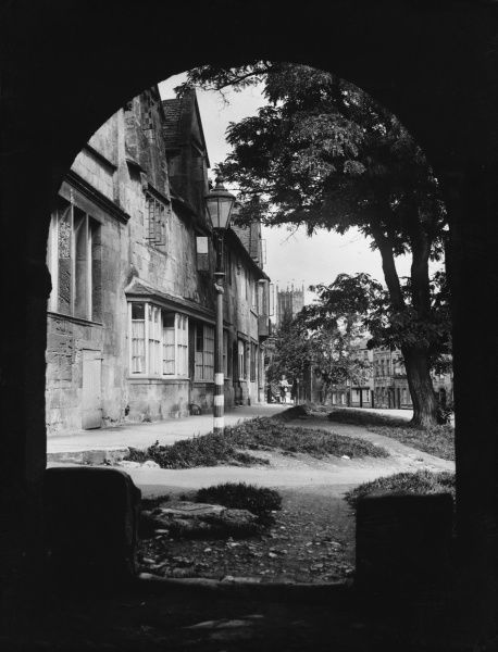 Chipping Campden, Gloucestershire, viewed through the arch of the 17th century Wool Hall. It was once the centre of the Cotswolds wool trade