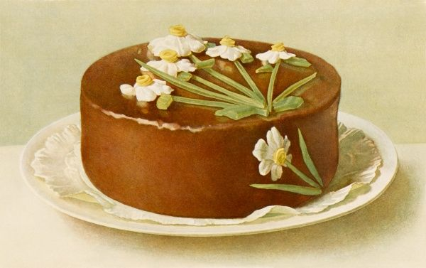A chocolate cake decorated with daffodils
