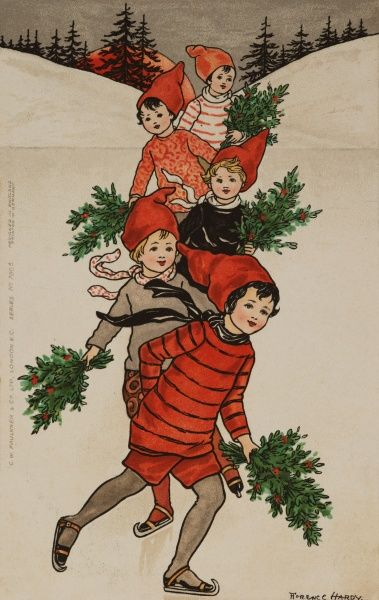 A quintet of children in winter jerseys and pointed caps skate in unison on a pond holding bunches of holly in a very festive manner