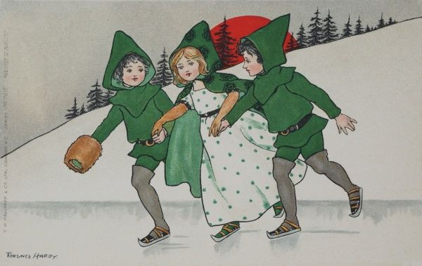Three small children, looking very festive in their matching green elfin capes skate together across a frozen pond