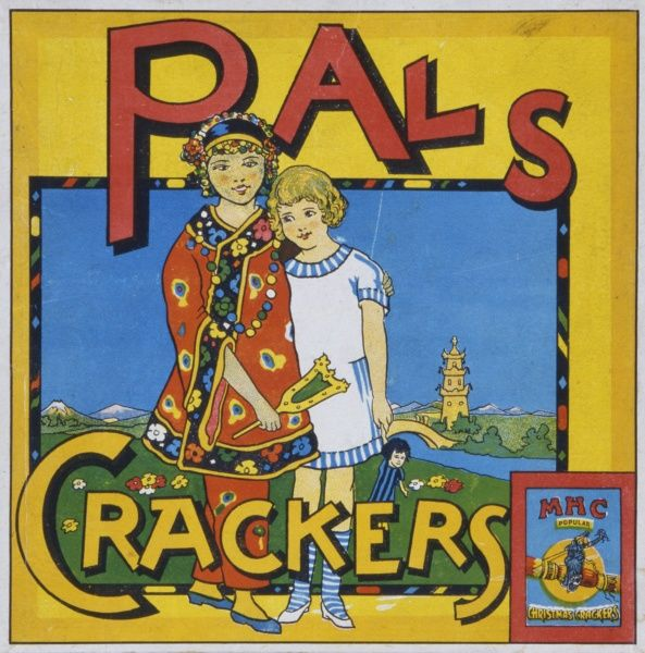Label for a box of Pals Christmas crackers featuring a little girl in Western dress embracing a Chinese girl in traditional costume