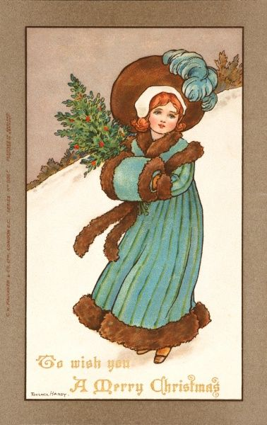 A young girl dressed in an early Victorian style blue coat and bonnet walks through the snow carrying a sprig of holly