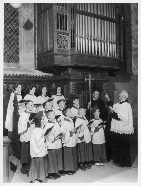 A church choir of boys and girls singing joyfully