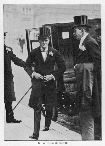 WINSTON CHURCHILL arrives at Church on his wedding day wearing a frock coat with buttonhole, bow tie, top hat, gloves & narrow fitting trousers