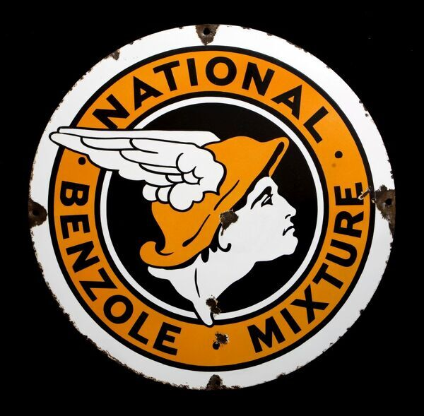 A round enamel sign advertising National Benzole Mixture, featuring the company logo, the head of the Messenger God Mercury. *EDITORIAL USE ONLY*