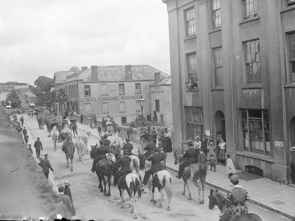 The circus parades along New Bridge in Haverfordwest, Pembrokeshire, Dyfed, South Wales, with elephants, camels and horses