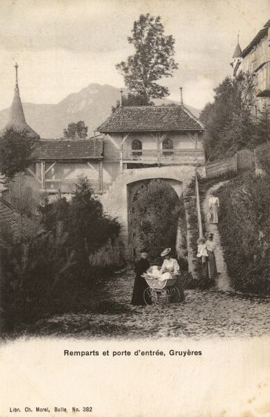 The City Walls/Ramparts and gate at Gruyeres, Canton of Frisburg, Switzerland Date: circa 1900