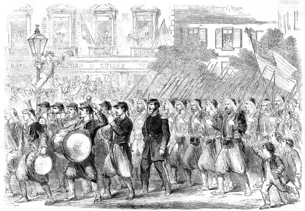The Pictuesque New York zouave regiments dressed in distinctive baggy trousers worn by freedom fighters in Hungary. Here they are shown passing through Broadway on their way to embark for the wars 'down south&#39