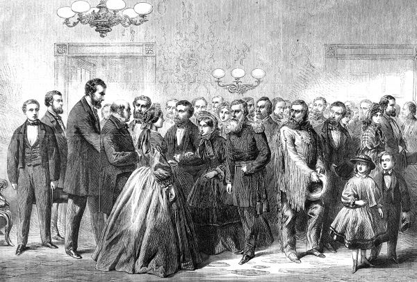 President Lincoln and his wife mingle with generals and scouts at a sombre reception at the White House, New Year, 1862