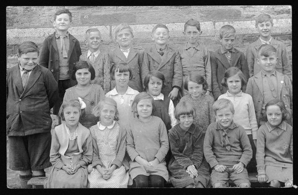 A rather cheeky group of pupils have their class photograph taken