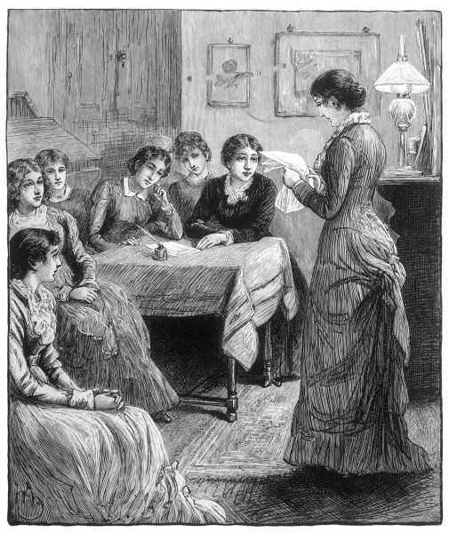A group of female students discuss a piece of school work
