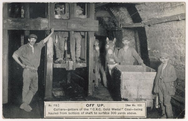 Colliers at the Clay Cross mine at Chesterfield, Derbyshire, England, wait at the bottom of the pit as their colleagues are hauled to the surface, 300 yards above