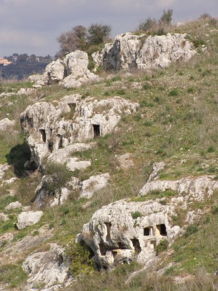 Cliff-face tombs carved into solid rock, Pantalica archaeological valley, near Ferla, Sicily, Italy