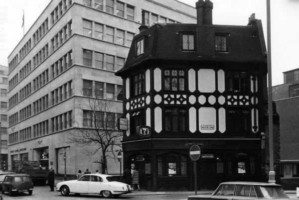 'The Coach & Horses', an old coaching inn on Bruton Lane, Mayfair, London, sitting rather incongruously among modern office blocks. Date: 1960s