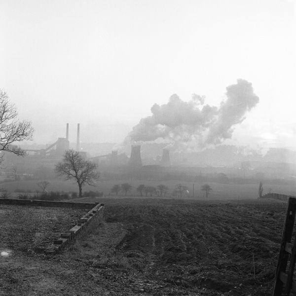 A Coal carbonisation Plant, Derbyshire with smoke emitting factory chimneys