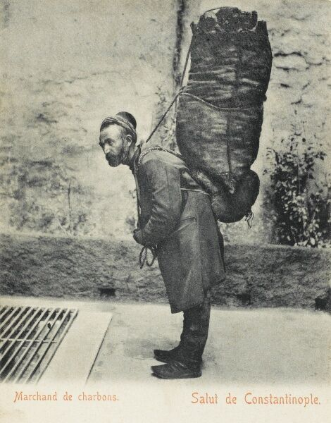 Coal Merchant, showing a classic example of a leather back support, which enabled such potentially heavy and awkward loads to be transported