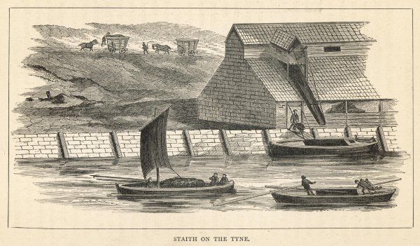 A staith, from which coal is being transferred onto barges, on the river Tyne, north-east England