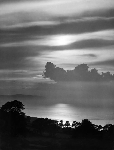 Sunset over the sea, off the coast at Minehead, Somerset, England. Date: 1930s